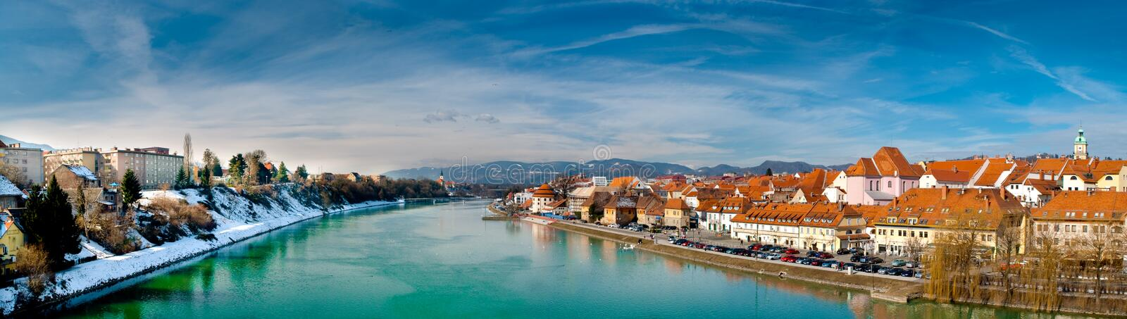 City Maribor and river Drava. View of city Maribor and river Drava from bridge. To the right is old town and to the left are new buildings stock image