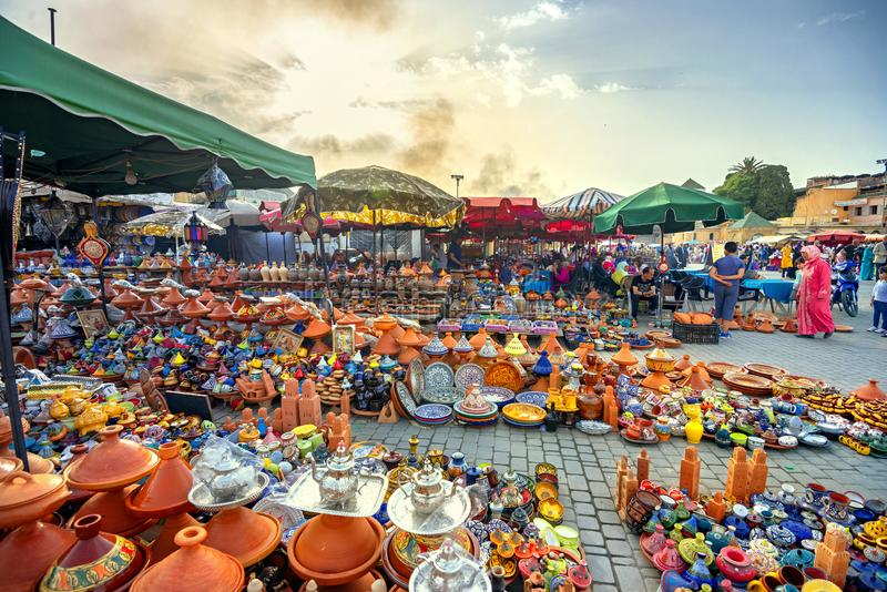 City market for sale of traditional tajines, clay pots at Meknes. Maghreb, Morocco, North Africa. MEKNES, MOROCCO - JULY 02, 2018:  Sale of colorful pottery stock image