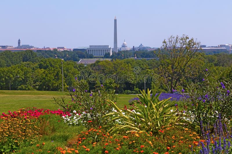Washington DC panorama in spring with blooming flowers and capital city attractions along Potomac River. City monuments and other landmarks such the Library of stock image