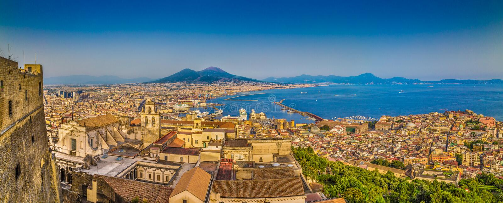 City of Naples with Mt. Vesuvius at sunset, Campania, Italy. Panoramic view of the city of Napoli (Naples) with famous Mount Vesuvius in the background in golden royalty free stock photography