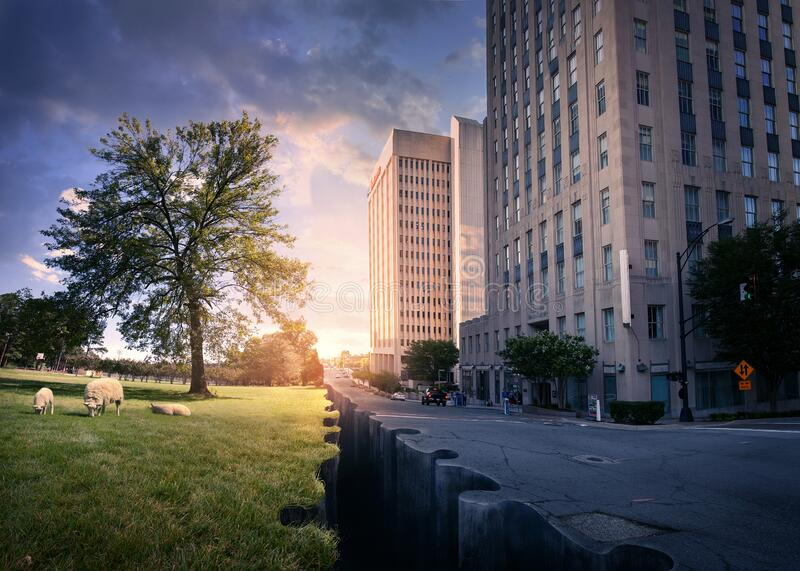 City and Nature joined by puzzle pieces stock photography