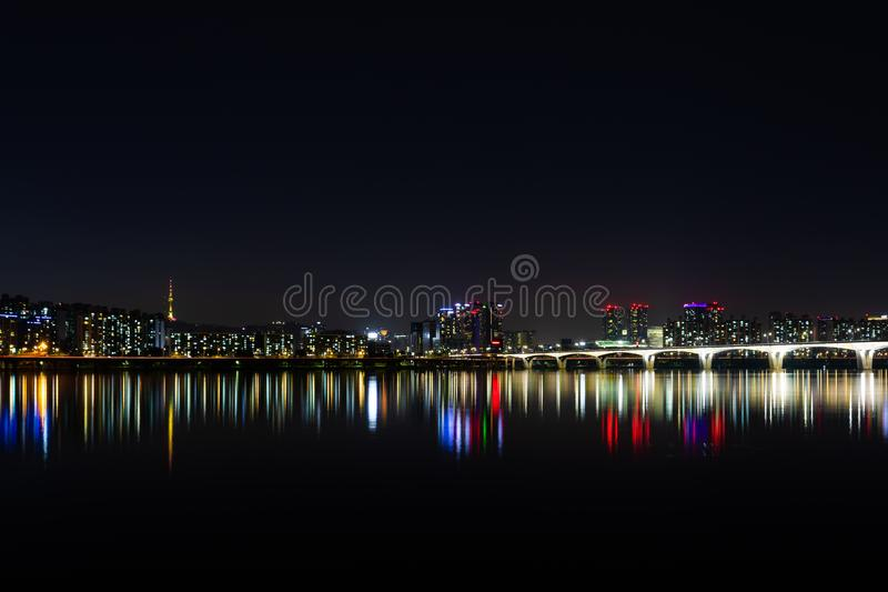 City Near Bodies of Water during Night Time royalty free stock image