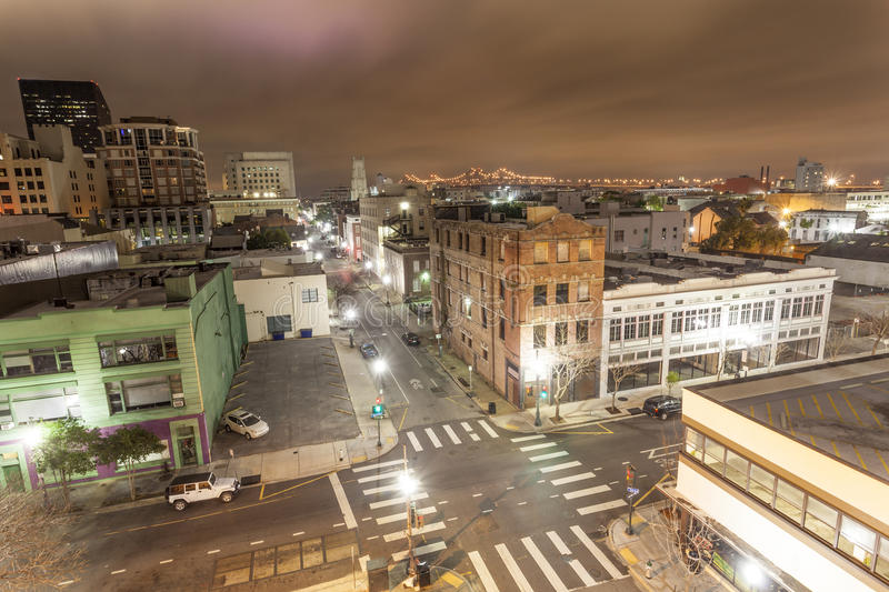 City of New Orleans at night. New Orleans downtown district illuminated at night. Louisiana, United States stock photos