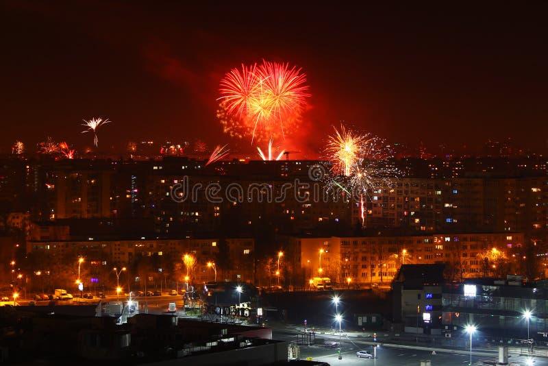 City night fireworks New Year`s Eve. Fireworks at night in city at New Year`s Eve stock image