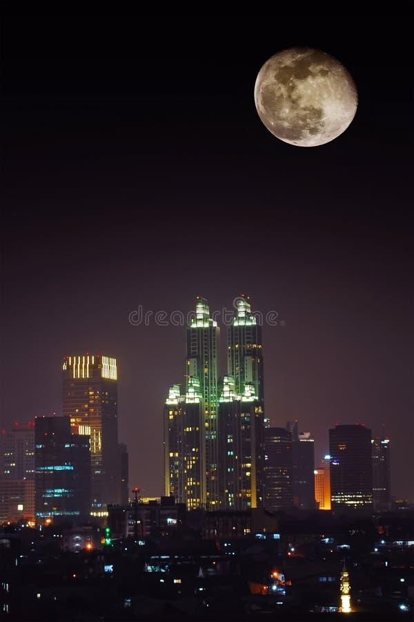 city night full moon stock photo