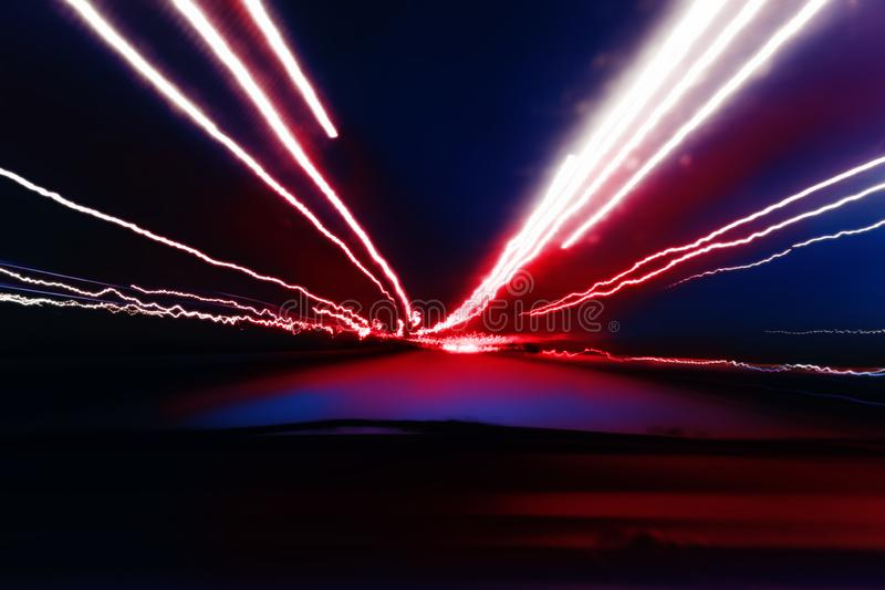 City night lights perspective blurred by high speed of the car.  stock photography