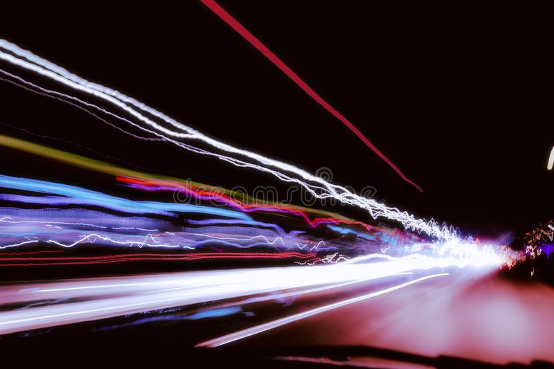 City night lights perspective blurred by high speed of the car.  royalty free stock image