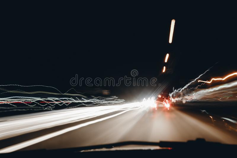 City night lights perspective blurred by high speed of the car.  royalty free stock images