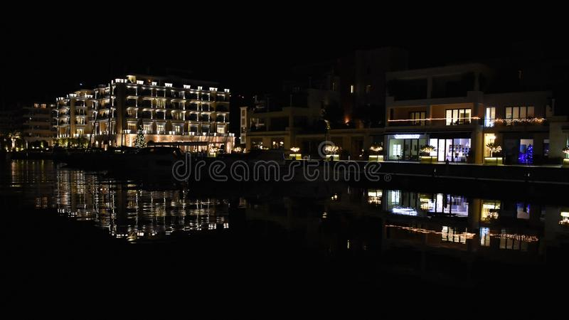 City at night. Luxury complex by the sea stock photos