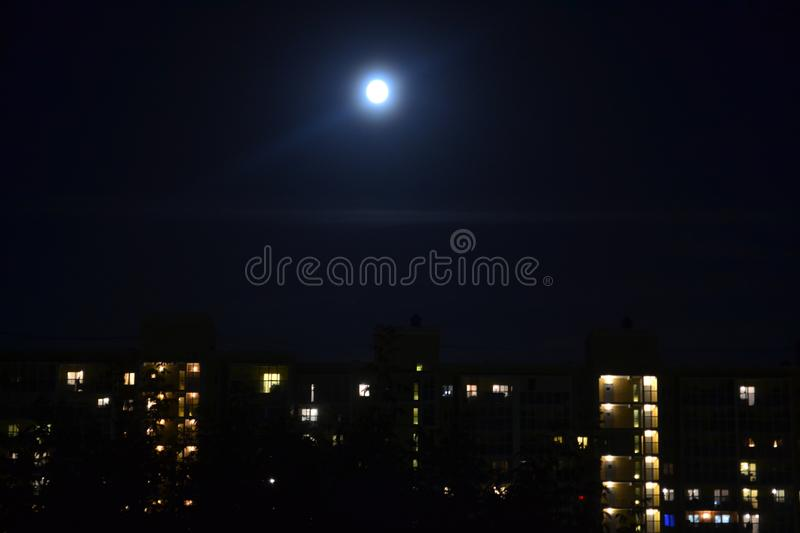 City at night. Moon and dwelling house. Yekaterinburg, Russia. Cityscape, lifestyle, light royalty free stock image