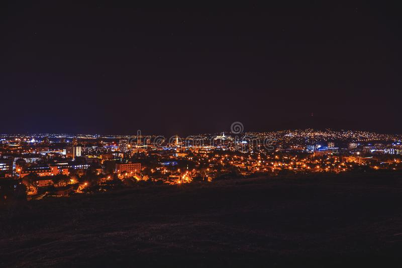 City night in Nitra from the view point on top of Hill mountain. Slovakia. Slovak city Nitra with purple night sky. City center stock images