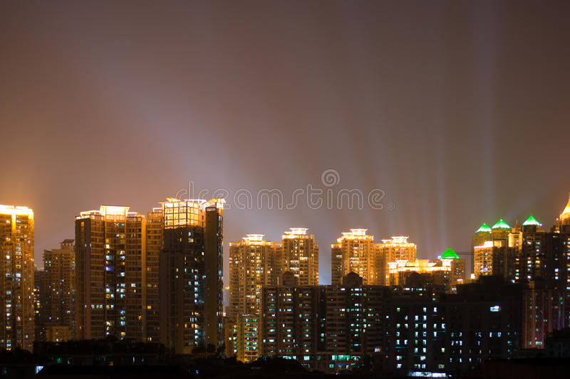 City night scene. The city night scene with spotlight in the background stock photography