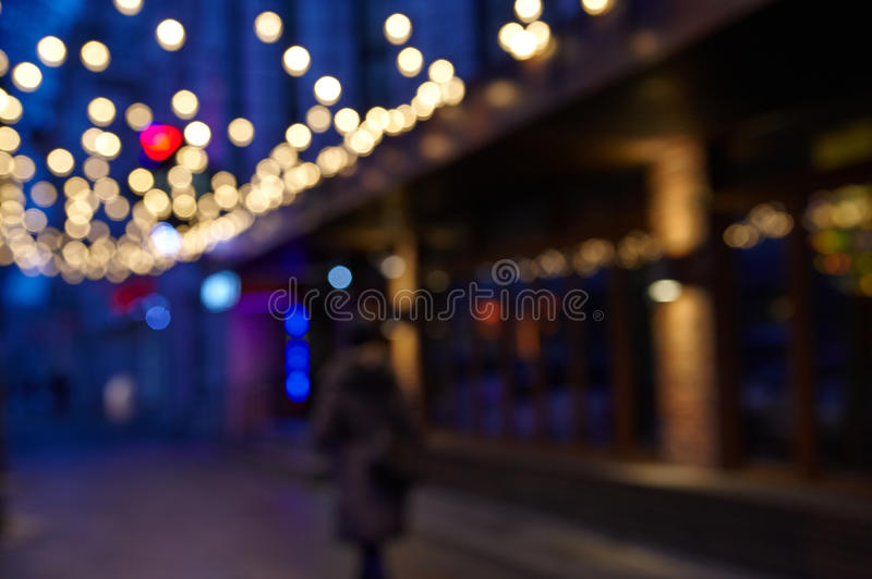 City night scene, abstract background blurr. People walking in the city night scene, abstract background blurr stock image