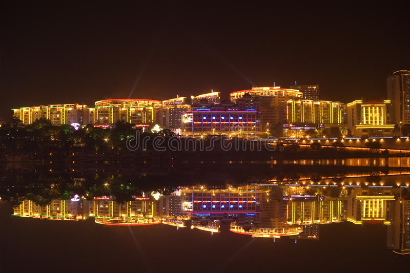 City night scene. At night, the city building reflection in the water. photo taken in liuzhou city,china royalty free stock photography