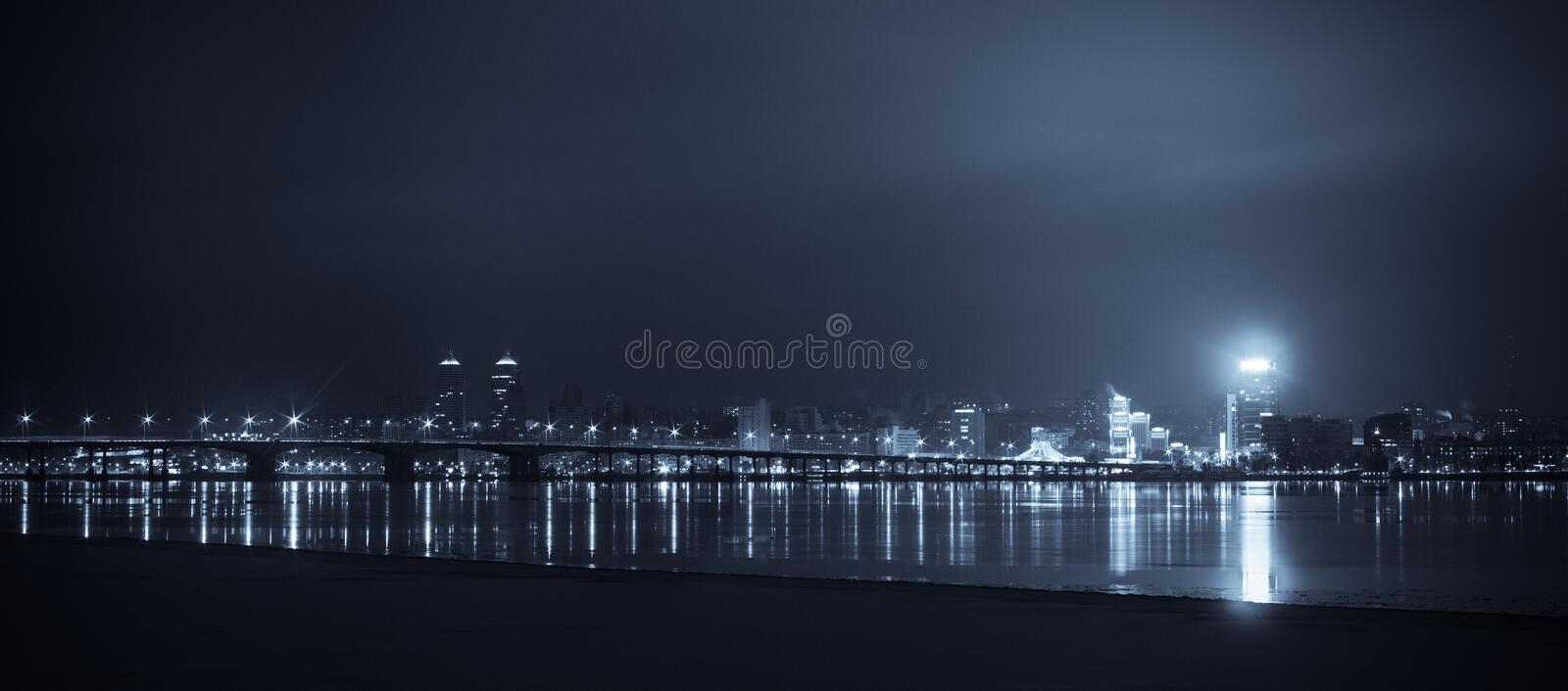 City of night. Night Skyline of Dnipropetrovsk with Reflection in the river Dnipro, Ukraine royalty free stock photography