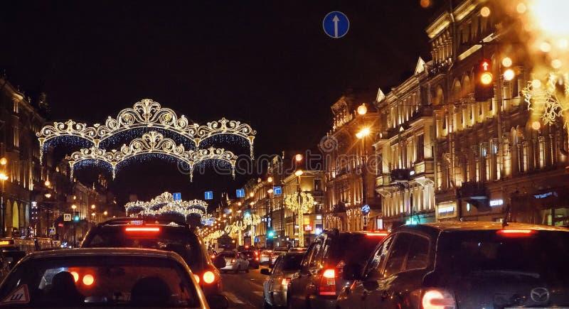Sankt-Petersburg city night streetlight illuminated cars road sky outdoors garland lights. City night winter sky road cars garland lights illuminated christmas stock images
