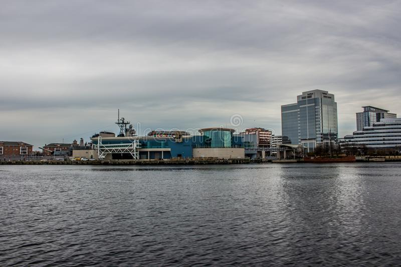 City of Norfolk Virginia from the Intercoastal Waterway. Sun reflecting off the calm ICW water. Cloudy Sky. Buildings stock photography
