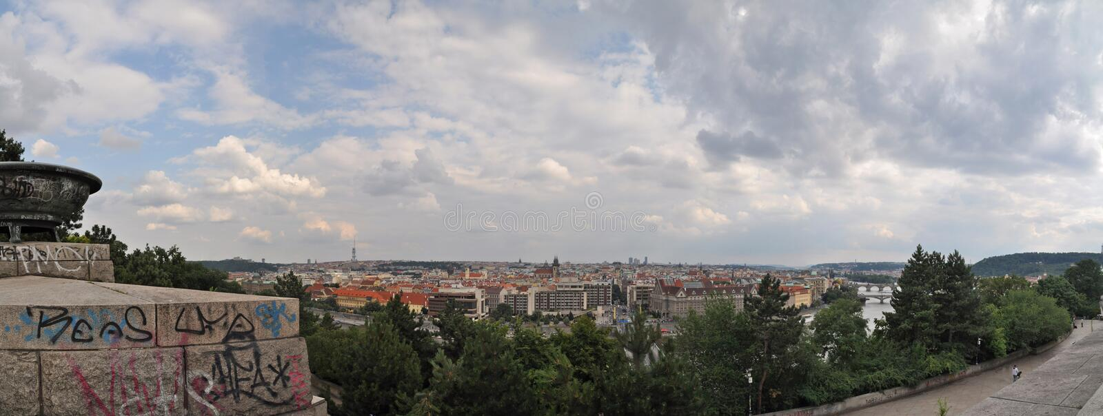 City panorama with graffiti and trees. Panorama of European city with buildings, trees, river and some graffiti royalty free stock photo