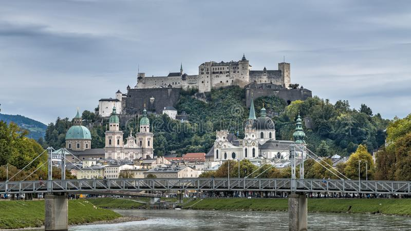 City panorama of historical sights in baroque city Salzburg, Austria. Autumn city landscape with Festung Hohensalzburg and Salzach royalty free stock images