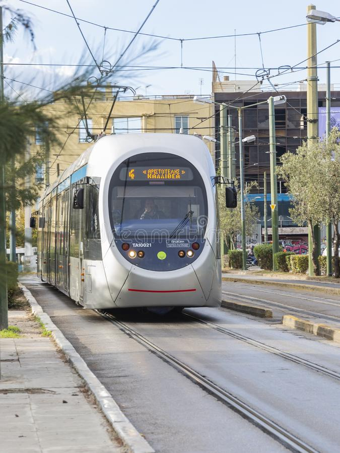 City passenger tram rides on rails stock images