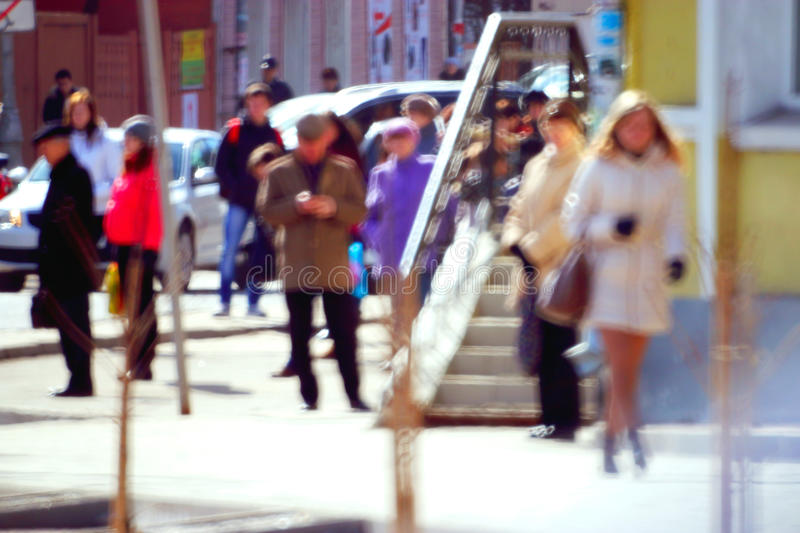 City pedestrians on the street. City​​ pedestrians on the street blurred background bokeh stock photos