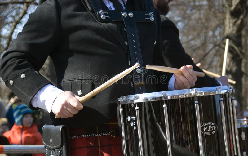 City Pipes. A piper band performing at Saint Patrick`s Day celebration royalty free stock photo