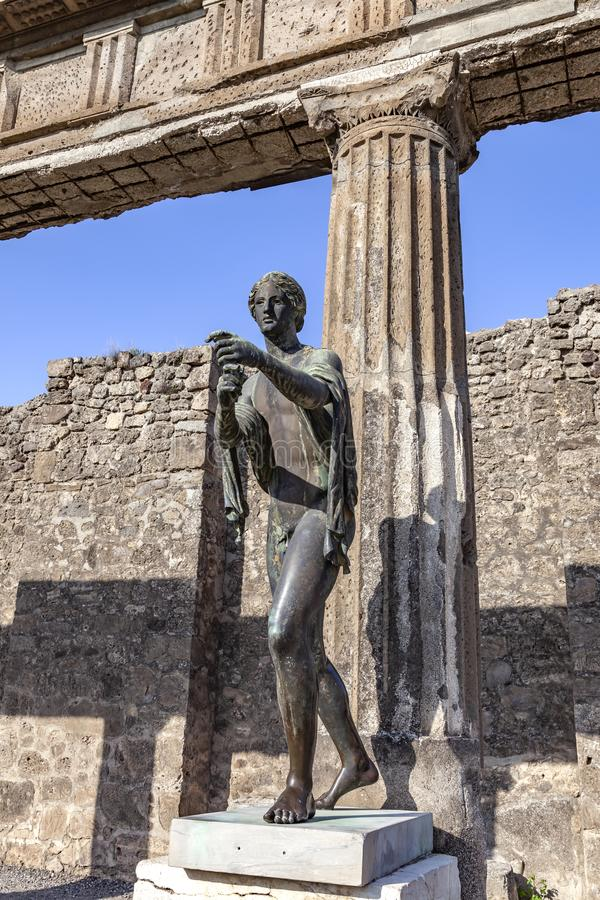 The city of Pompeii buried under a layer of ash by the volcano Mount Vesuvius. Temple of Apollo. Sculpture stock photography