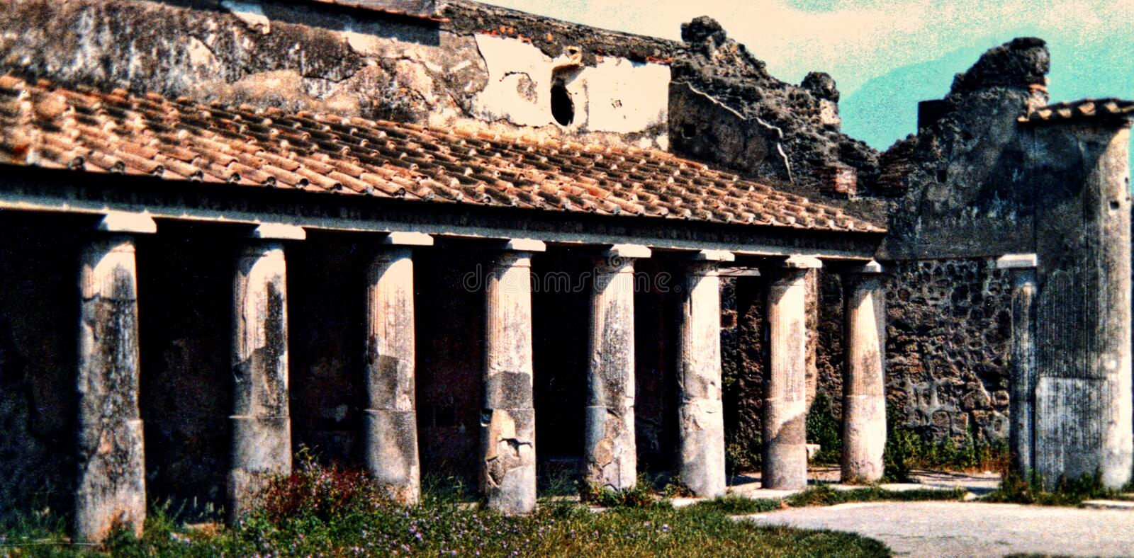 Pompeii Italy, circa 1984, ruins of a public building. City of Pompeii Italy, circa 1984, ruins of a public building that had been significantly recovered by royalty free stock image