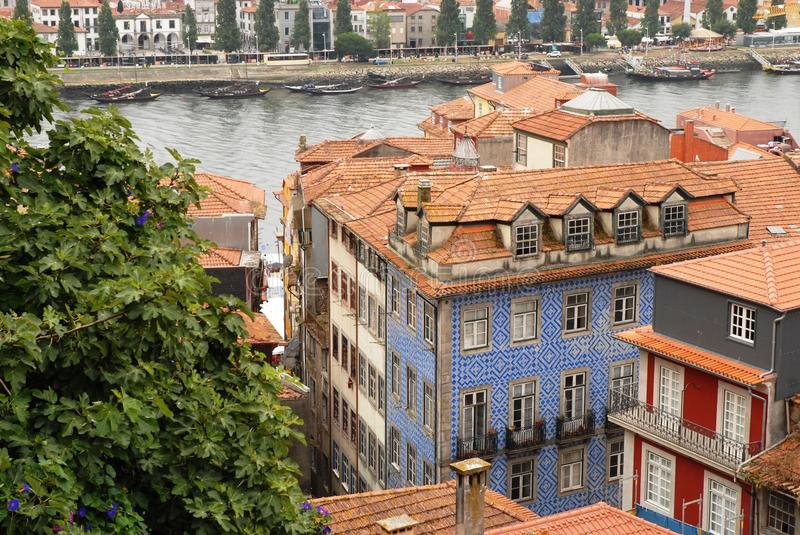 The city of Porto in Prtogallo. The city of Porto in Portugal. Some buildings, one in the foreground, seen from above. Typical houses, colorful and overlooking stock photography