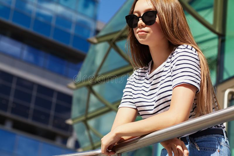City portrait of a stylish young woman in sunglasses stock photo