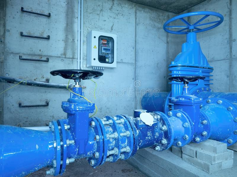 City potable water pipeline in concrete shafts with 500mm Gate valve. 250mm armature branch. The dring water service and Water network maintenance stock photo