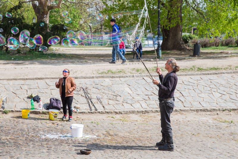 City Prague, Czech Republic. A man on the street blowing bubbles. 2019. 24. April stock photography