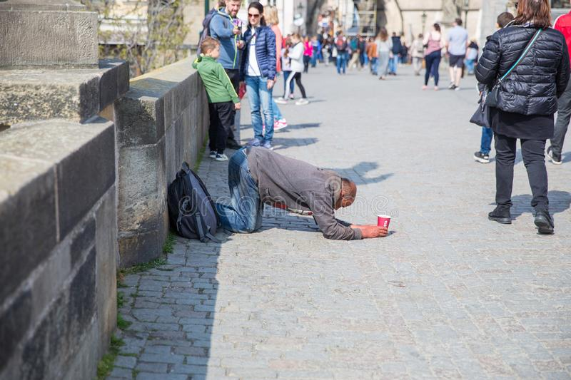 City Prague, Czech Republic. On the street the beggar treats people for money. 2019. 24. April royalty free stock images