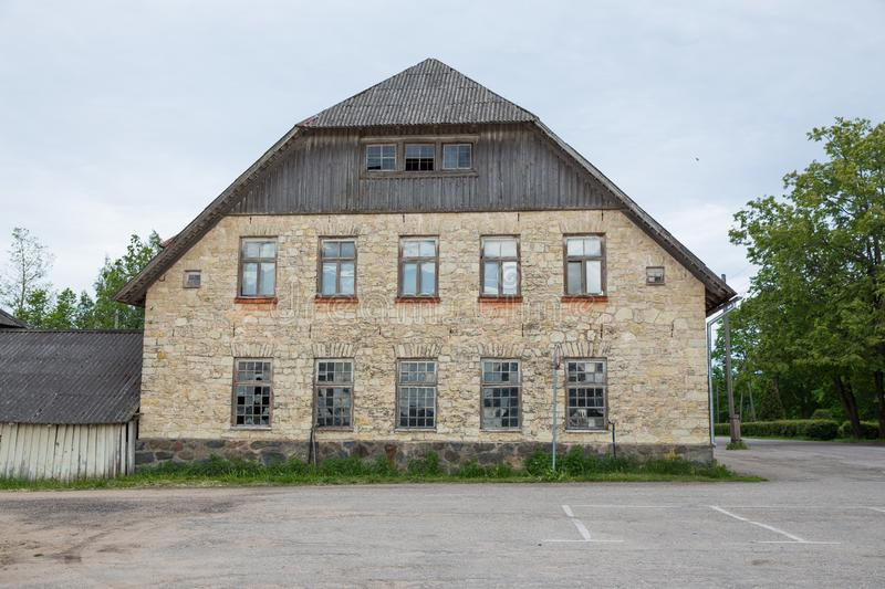 City Priekuli, Latvian Republic. Old house and street view. Windows and roof. Jun 1. 2019 Travel photo royalty free stock images