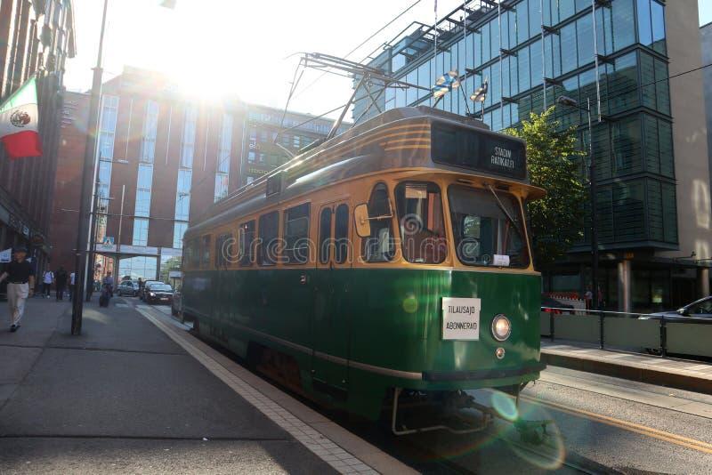 City public transport green train tram on streets of Helsinki royalty free stock photos