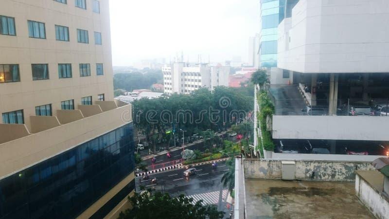 City on rain stock photos