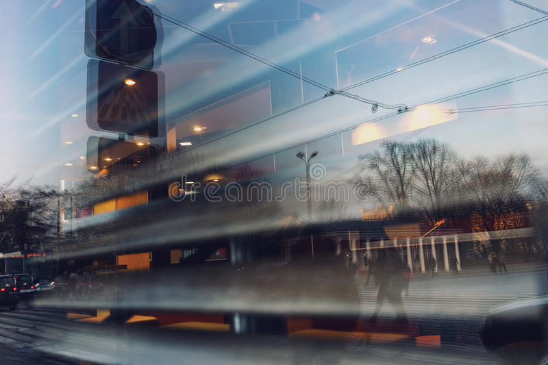 The city is reflected in the window of a cafe with shutters stock photos