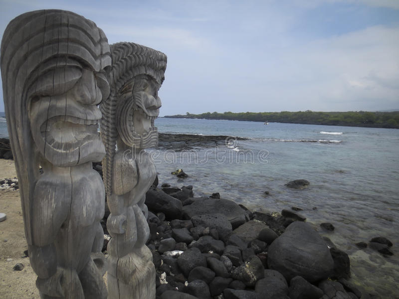 City of Refuge Hawaii. Tiki type statues at Puʻuhonua o Hōnaunau National Historical Park better known as the City of Refuge on the Big Island of Hawaii royalty free stock image