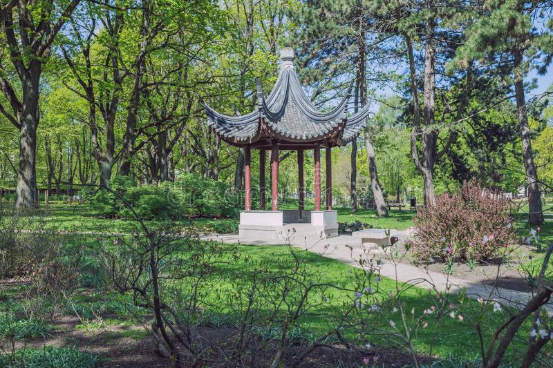 City Riga, Latvia Republic. City park with china gazebo. Trees and nature. May 7. 2019 Travel photo stock image
