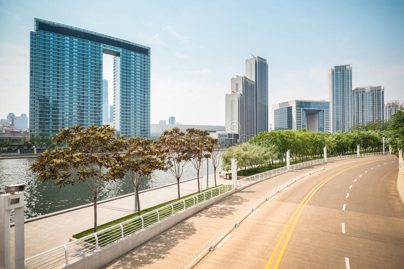 City road and modern building. In tianjin financial center stock photos