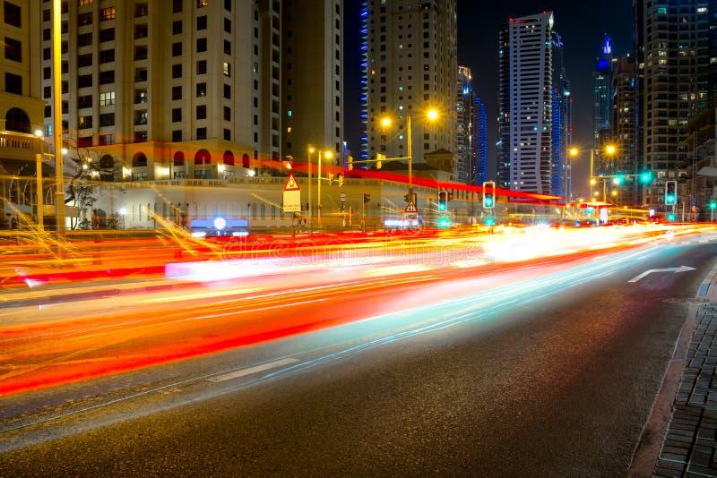 City road night scene, UAE, Dubai, Night traffic long tracers in Dubai UAE center stock photos