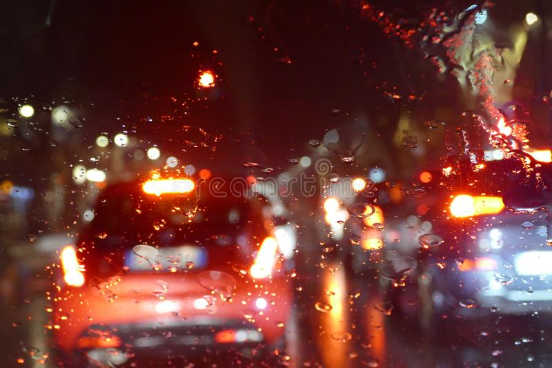 Road traffic in rainy night tunnel with cars and lights blur effect. City road traffic in rainy night tunnel with cars and lights blur effect stock photos