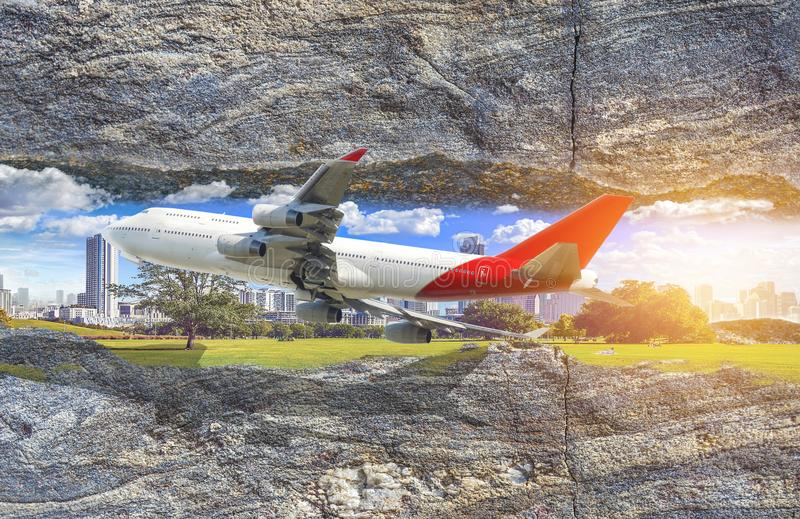 A city in a rock crevice. The plane flies into the crack in the stock photography