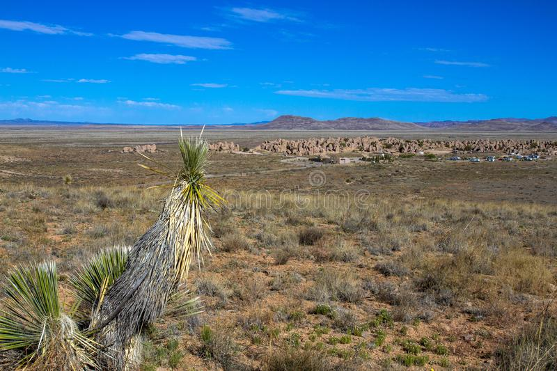 Long view of City of Rocks State Park near Silver City, New Mexico. View of City of Rocks State Park in New Mexico, with a large Soaptree Yucca in the foreground stock images