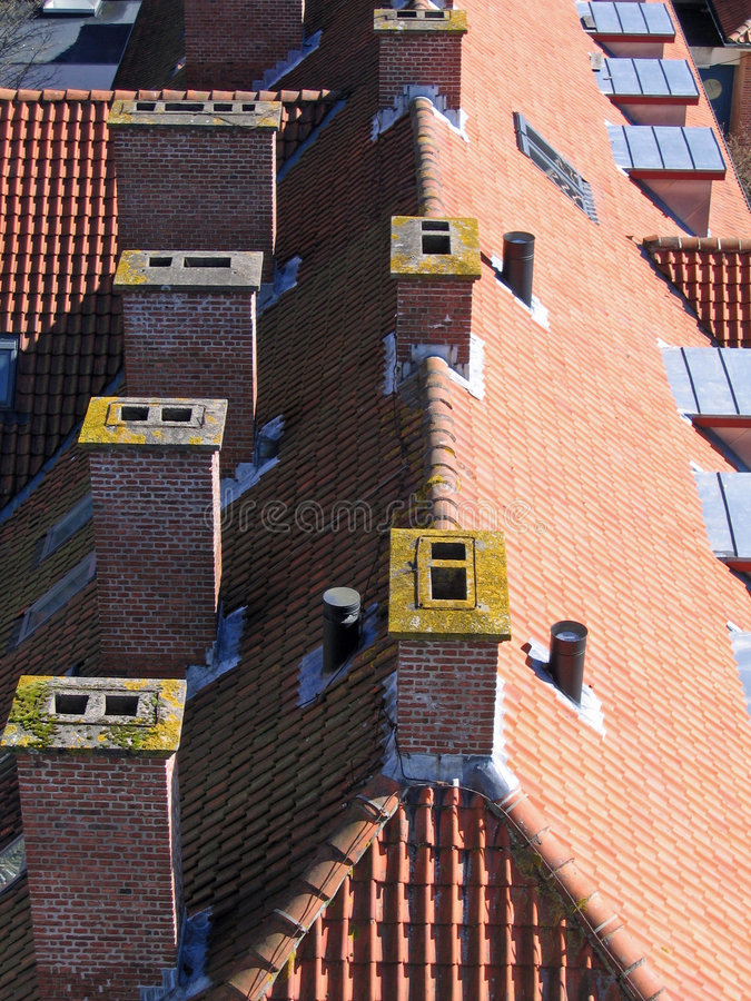 City roof tops. Roofs of houses in the big city stock image