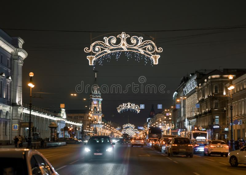 City Saint-Petersburg night illumination road cars. Saint-Petersburg historical building city night road cars light illustration royalty free stock photos