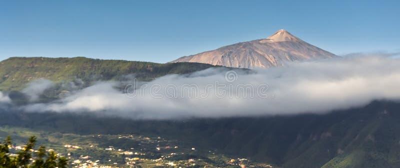 El Teide in Tenerife. The city of Santa Cruz de Tenerife under the mist of El Teide volcano royalty free stock photo