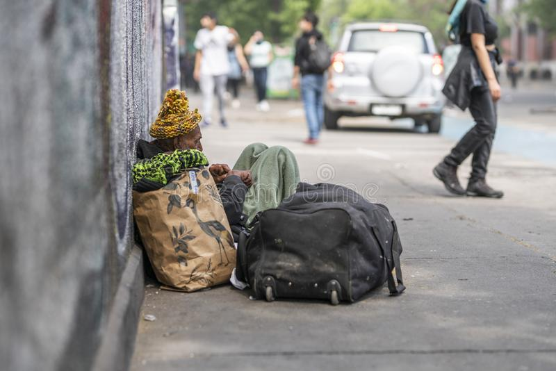 Indifferent humble homeless at Santiago city streets during October 2019 riots stock photo