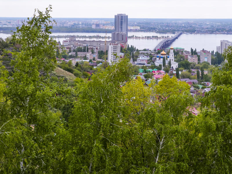 The City Of Saratov, Russia. Road bridge across the Volga river between the cities of Saratov and Engels. Spring, green trees royalty free stock image
