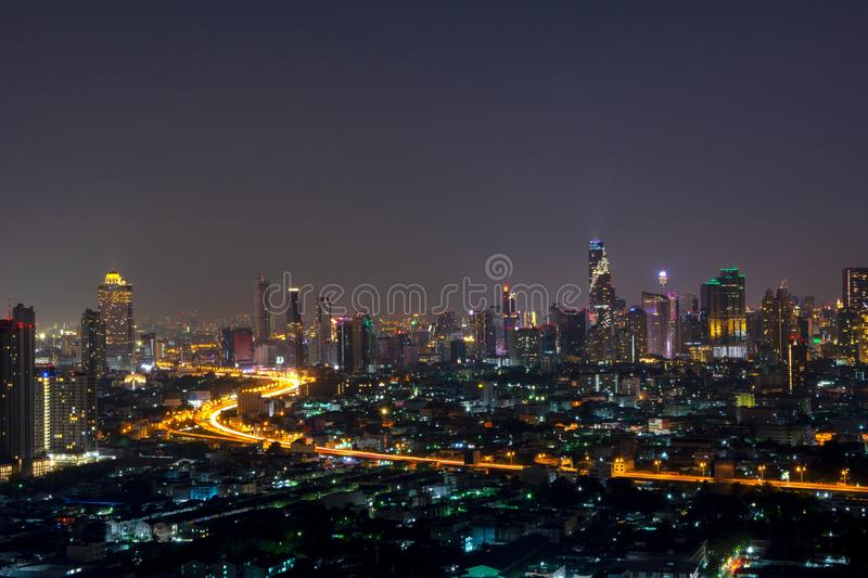 City scape of skyscrapers with lights on in the offices by night royalty free stock images